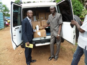 CHASL Pharmacist Making Drugs donated by CHASL with Support from BMZ/DKH to Eugene of St John of God