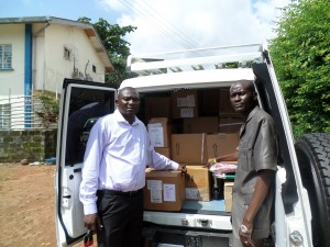CHASL Pharmacist Making Drugs donated by CHASL with Support from BMZ/DKH to Mr Joseph Lahai of Serabu