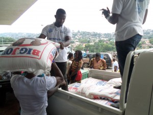CHASL Staff oflaoding the rice for the donation to flood victims